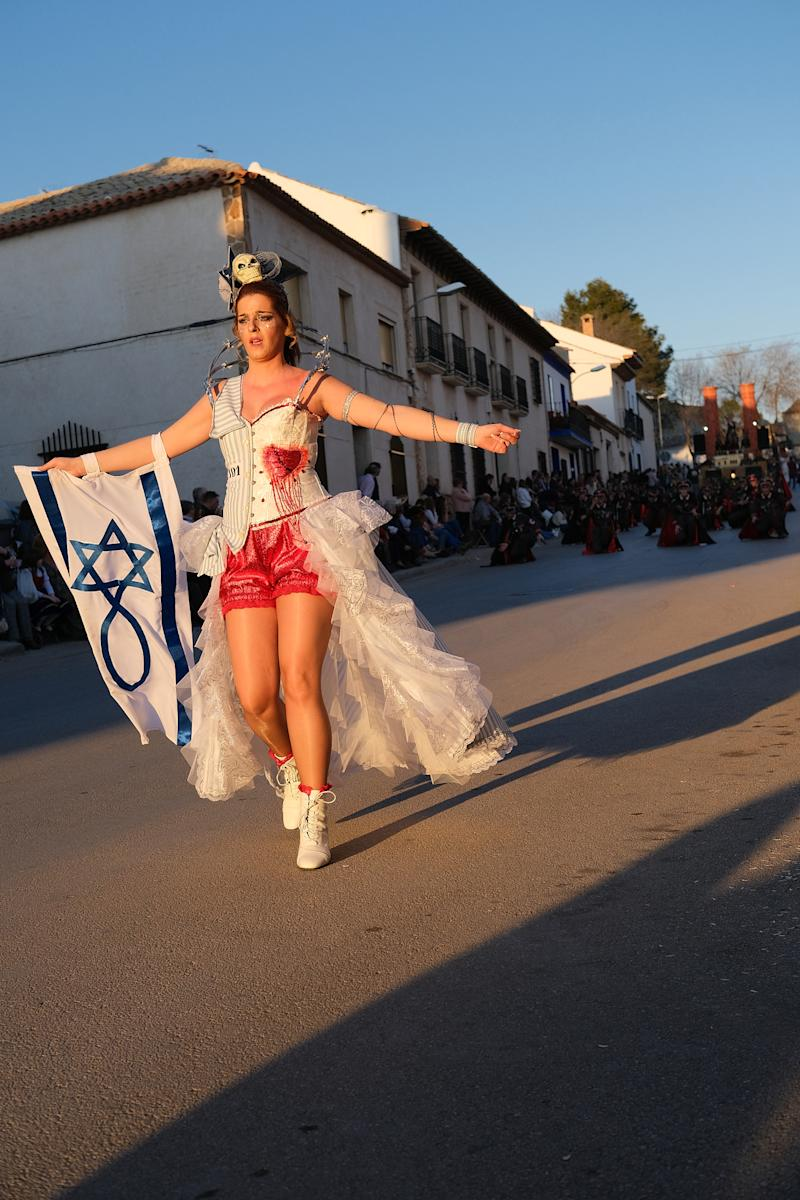 CAMPO DE CRIPTANA, SPAIN - FEBRUARY 24: A women with an Israeli flag is seen in a Holocaust-themed parade during Carnival festivities on February 24, 2020 in Campo de Criptana, Spain. The Embassy of Israel in Spain denounced the display as trivializing the Holocaust. (Photo by Rey Sotolongo /Europa Press via Getty Images)