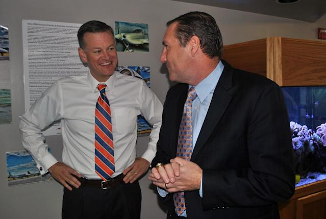 Scott Stricklin chops it up with Dan Mullen after hiring him to be Florida's head football coach. (AP Photo/Mark Long)