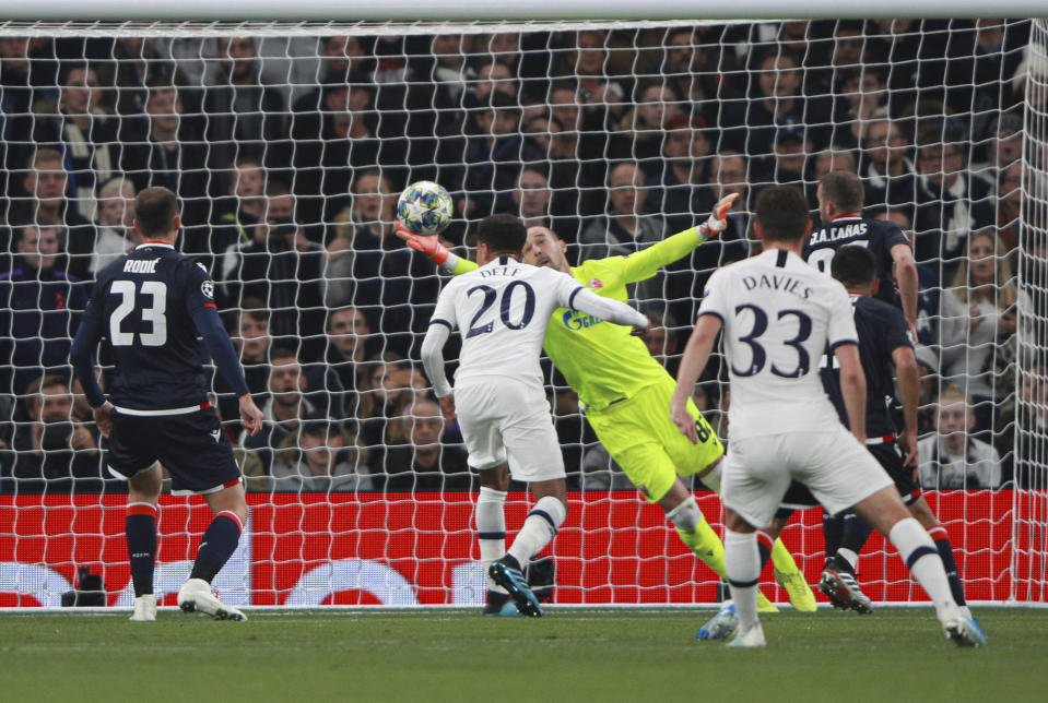Red Star's goalkeeper Milan Borjan fails to save a shot by Tottenham's Harry Kane during the Champions League, group B, soccer match between Tottenham and Red Star Belgrade, at the Tottenham Hotspur stadium in London, Tuesday, Oct. 22, 2019. (AP Photo/Ian Walton)