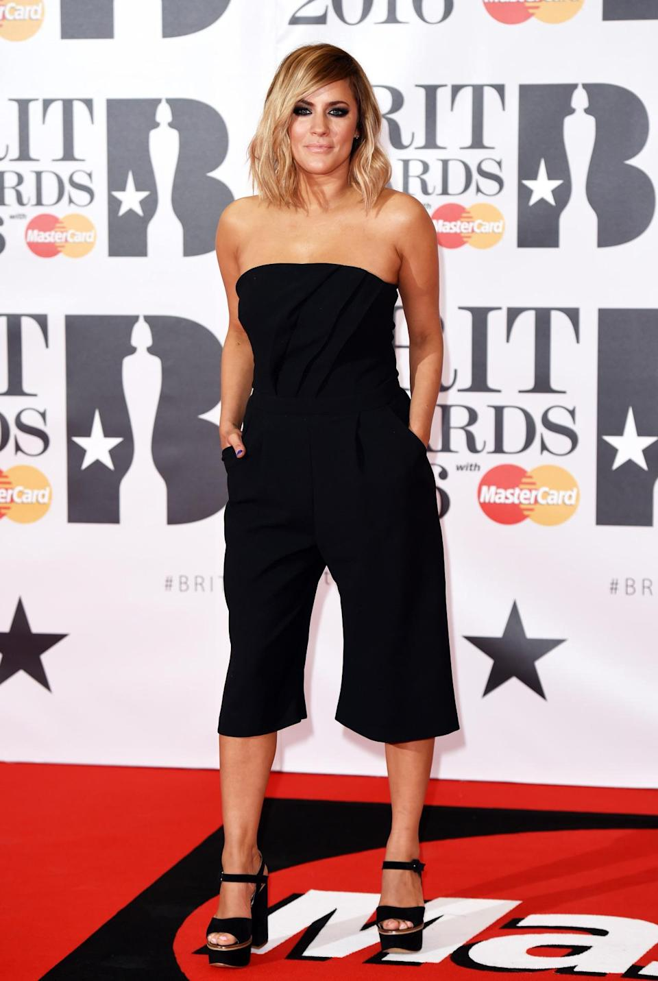 <p>The TV presenter kept things simple (a little too simple, perhaps) in a cropped black jumpsuit. <i>[Photo: Rex]</i></p>