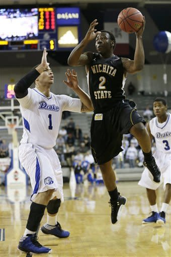 Wichita State guard Malcolm Armstead (2) drives to the basket past Drake forward Jordan Clarke, left, during the first half of an NCAA college basketball game on Wednesday, Jan. 2, 2013, in Des Moines, Iowa. (AP Photo/Charlie Neibergall)