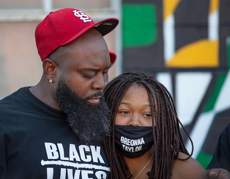 Michael Brown Sr. hugs Juniyah Palmer at the Until Freedom rally Louisville, Kentucky. Both lost loved ones in police shootings, Michael Brown Jr. and Breonna Taylor. Aug. 8, 2020