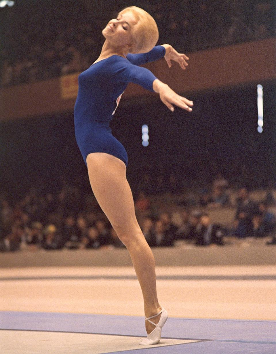 <p>Muriel Grossfeld of the U.S.A. shows off her form in the Women's Individual Standing gymnastics event.</p>