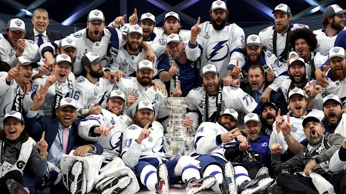 NHLI via Getty Images - EDMONTON, ALBERTA - SEPTEMBER 28: Captain Steven Stamkos #91 and his Tampa Bay Lightning teammates pose on the ice with the Stanley Cup after the Tampa Bay Lightning defeated the Dallas Stars 2-0 in Game Six of the NHL Stanley Cup Final to win the best of seven game series 4-2 at Rogers Place on September 28, 2020 in Edmonton, Alberta, Canada. (Photo by Dave Sandford/NHLI via Getty Images)