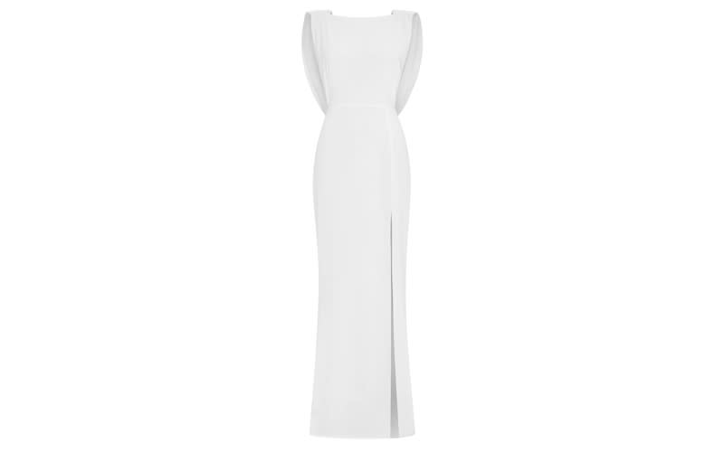 """<p>If you think the thigh-high split is enough to make this 'the one' then make sure to check out the swooping cowel back. <a rel=""""nofollow noopener"""" href=""""https://www.outlinelondon.com/clothing/wedding/the-evelyn-dress"""" target=""""_blank"""" data-ylk=""""slk:Shop now"""" class=""""link rapid-noclick-resp""""><em>Shop now</em></a>. </p>"""