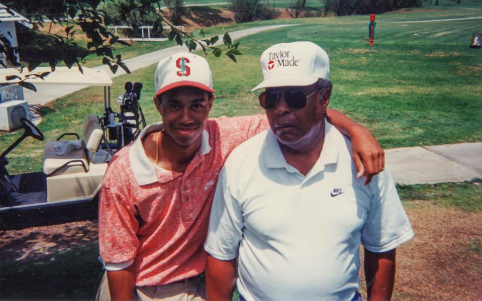 A young Tiger Woods with his father, Earl - HBO