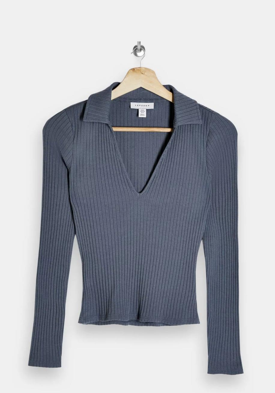 <p>This flattering <span>Long Sleeve Ribbed Collar Top</span> ($26) will tuck effortlessly into any bottoms.</p>