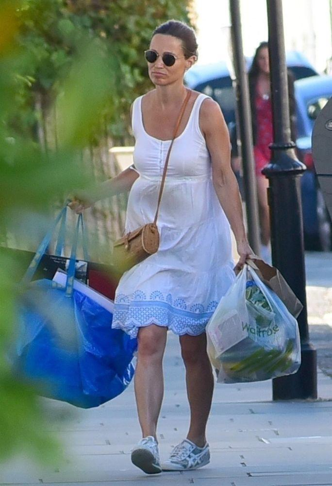 3c5cc022c9 Pregnant Pippa Middleton Just Channeled Sister Kate in the Perfect Summer  Maternity Dress