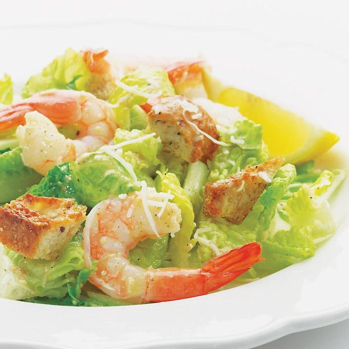 "<p>This shrimp Caesar salad is a twist on the classic in more ways than one. Instead of drowning the greens in a heavy dressing, this lemony version lets the taste of the shrimp shine through. And don't worry about the anchovies—they'll mellow in the dressing, giving it a rich taste that can't be duplicated. <a href=""https://www.eatingwell.com/recipe/253089/shrimp-caesar/"" rel=""nofollow noopener"" target=""_blank"" data-ylk=""slk:View recipe"" class=""link rapid-noclick-resp""> View recipe </a></p>"
