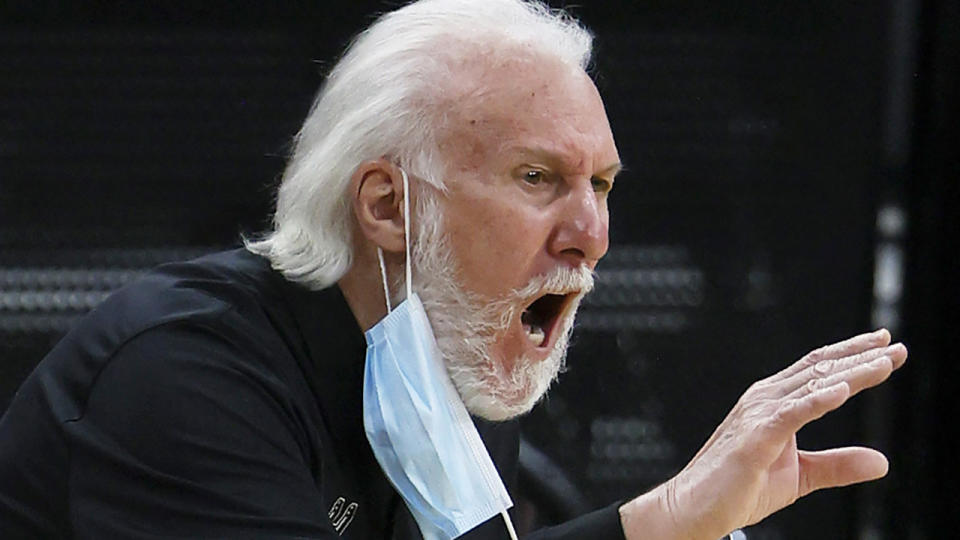 San Antonio Spurs head coach Gregg Popovich became the third NBA coach to surpass 1300 victories in the league. (Photo by Tom Pennington/Getty Images)