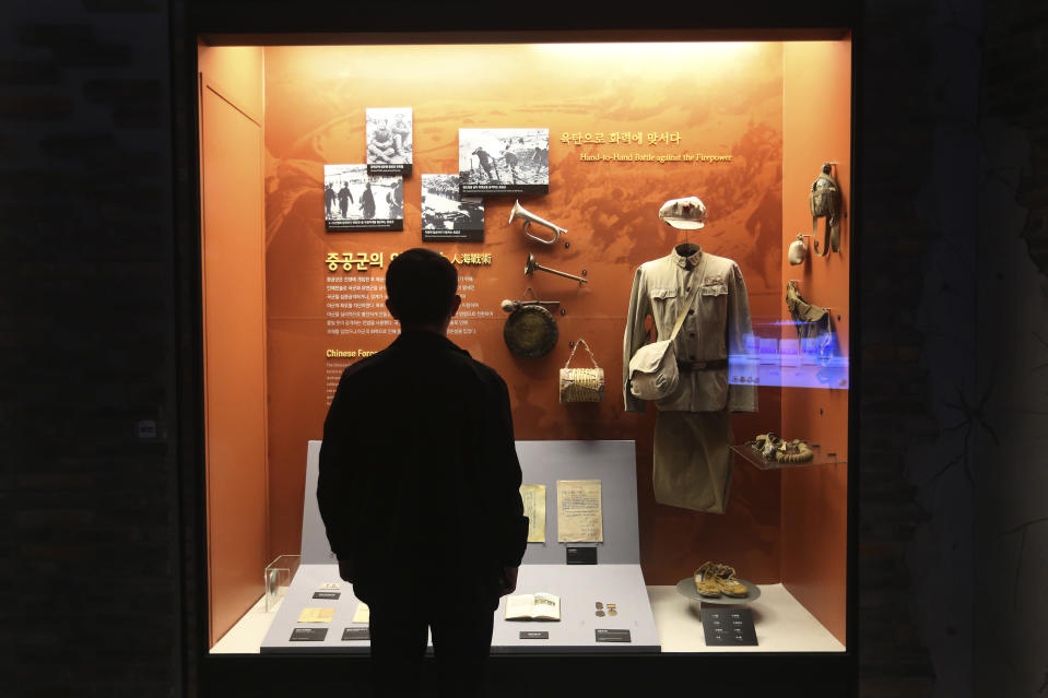 "A visitor watches a Chinese military uniform and equipments used during the Korea War at the Korea War Memorial Museum in Seoul, South Korea, Friday, Oct. 23, 2020. Chinese leader Xi Jinping condemned ""unilateralism, protectionism and extreme egoism"" in a jab at the United States made during a rally Friday to mark the 70th anniversary of China's entry into the 1950-53 Korean War. (AP Photo/Ahn Young-joon)"