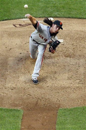 San Francisco Giants pitcher Tim Lincecum delivers against the Arizona Diamondbacks in the second inning of an opening day baseball game, Friday, April 6, 2012, in Phoenix. (AP Photo/Matt York)