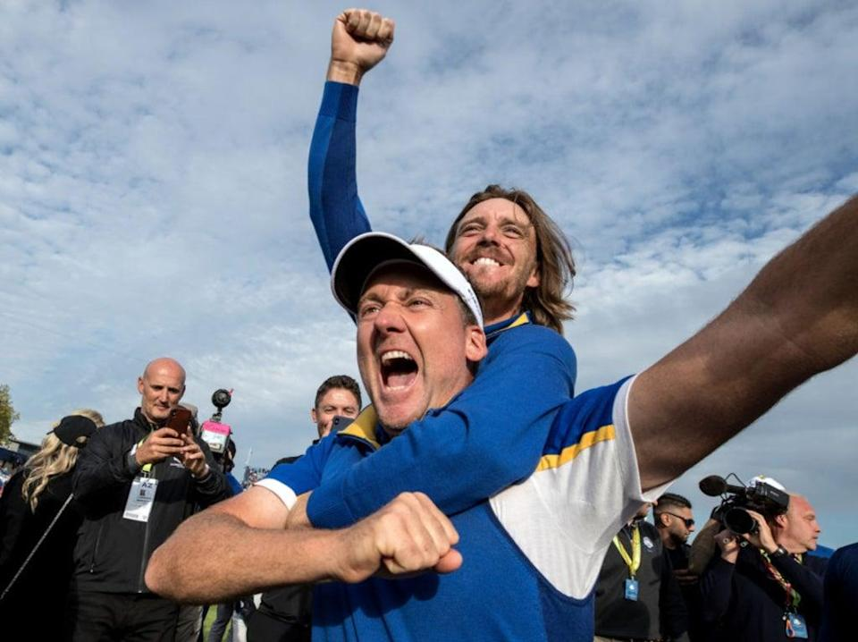 We'll always have Paris: Ian Poulter and Tommy Fleetwood celebrate victory after the singles matches at Le Golf National in 2018 (Getty)
