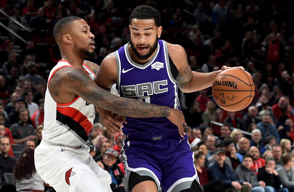 Sacramento Kings guard Cory Joseph, right, tries to get past Portland Trail Blazers guard Damian Lillard, left, during the first half of an NBA basketball game in Portland, Ore., Wednesday, Dec. 4, 2019. (AP Photo/Steve Dykes)