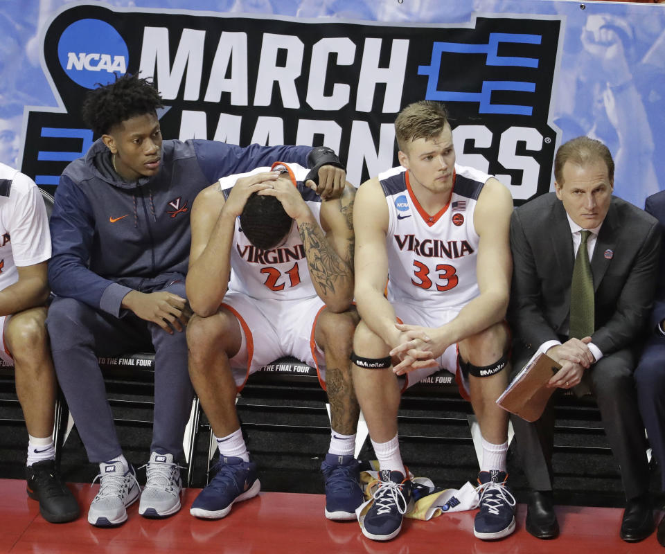 Virginia's Isaiah Wilkins (21) is consoled after fouling out during the second half of a first-round game against UMBC in the NCAA men's college basketball tournament. (AP)