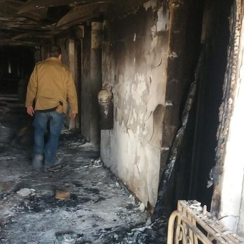 A burned corridor of the Intercontinental Hotel a day after the attack in Kabul - Credit: REUTERS