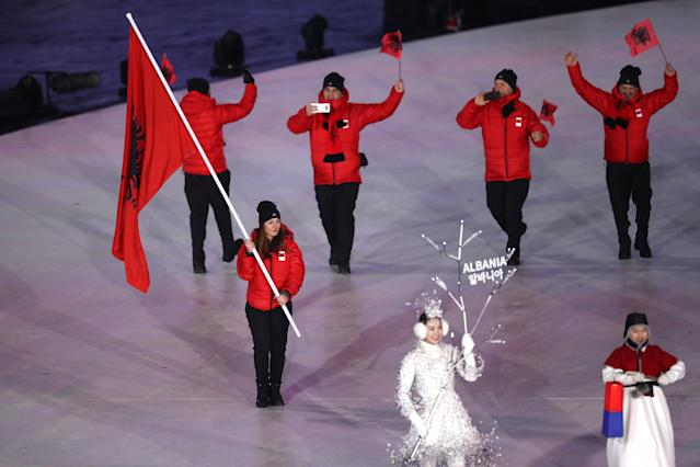 <p>Flag bearer of Albania Suella Mehelli leads the team during the Opening Ceremony of the PyeongChang 2018 Winter Olympic Games at PyeongChang Olympic Stadium on February 9, 2018 in Pyeongchang-gun, South Korea. (Photo by Ronald Martinez/Getty Images) </p>