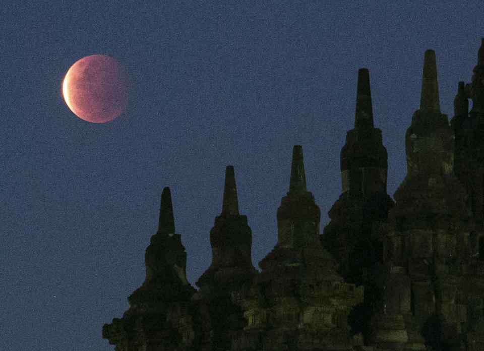 YOGYAKARTA, INDONESIA - MAY 26, 2021 : A view of total lunar eclipse called Super blood moon at Plaosan Buddha temple in Yogykarta, Indonesia on May 26, 2021. (Photo credit should read Kasan / Sijori Images/Barcroft Media via Getty Images)