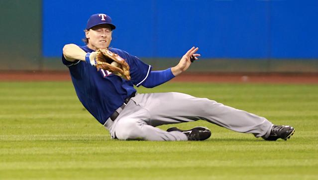 Texas Rangers Jim Addduci makes a sliding catch of a ball hit by Cleveland Indians' Michael Brantley in the fifth inning of a baseball game Friday, Aug. 1, 2014, in Cleveland. (AP Photo/Aaron Josefczyk)