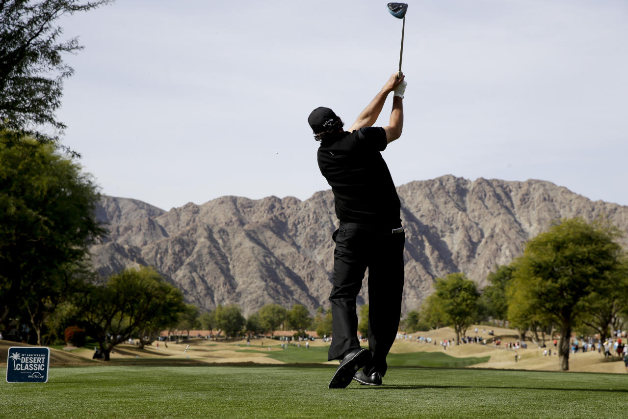 Phil Mickelson watches his tee shot on the third hole during the final round of the Desert Classic golf tournament on the Stadium Course at PGA West on Sunday, Jan. 20, 2019, in La Quinta, Calif. (AP Photo/Chris Carlson)