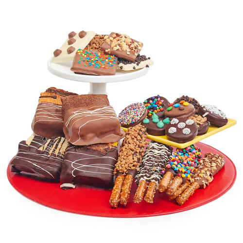 "<strong><h3><a href=""https://www.dylanscandybar.com/"" rel=""nofollow noopener"" target=""_blank"" data-ylk=""slk:Dylan's Candy Bar"" class=""link rapid-noclick-resp"">Dylan's Candy Bar</a></h3></strong><br>An NYC classic, Dylan's <a href=""https://fave.co/2GVfJ2Z"" rel=""nofollow noopener"" target=""_blank"" data-ylk=""slk:online sweet shop"" class=""link rapid-noclick-resp"">online sweet shop</a> is brimming with tackle boxes of colorful candy creations — the shippable spread spans creative treats from <a href=""https://www.dylanscandybar.com/Dylans-Candy-Bar-Valentines-Day-Chocolate-Covered-Donut-Pops-Bouquet.html"" rel=""nofollow noopener"" target=""_blank"" data-ylk=""slk:bouquets of chocolate-covered donut pops"" class=""link rapid-noclick-resp"">bouquets of chocolate-covered donut pops</a> to <a href=""https://fave.co/2IlnTCx"" rel=""nofollow noopener"" target=""_blank"" data-ylk=""slk:cake pops"" class=""link rapid-noclick-resp"">cake pops</a>, <a href=""https://www.dylanscandybar.com/Dylans-Candy-Bar-Signature-Chocolate-Tackle-Box-9414.html"" rel=""nofollow noopener"" target=""_blank"" data-ylk=""slk:signature chocolates"" class=""link rapid-noclick-resp"">signature chocolates</a>, rainbow hard candies, and much more.<br><br><strong>Dylan's Candy Bar</strong> Belgian Chocolate Covered Indulgence, $, available at <a href=""https://go.skimresources.com/?id=30283X879131&url=https%3A%2F%2Fwww.dylanscandybar.com%2Fcollections%2Fbest-sellers%2Fproducts%2Fdylans-candy-bar-belgian-chocolate-covered-indulgence-8688"" rel=""nofollow noopener"" target=""_blank"" data-ylk=""slk:Dylan's Candy Bar"" class=""link rapid-noclick-resp"">Dylan's Candy Bar</a>"