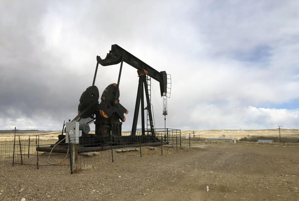 FILE - This Feb. 26, 2021, file photo shows an oil well east of Casper, Wyo. President Joe Biden shut down oil and gas lease sales from the nation's vast public lands and waters in his first days in office, citing worries about climate change. Now his administration has to figure out what do with the multi-billion dollar program without crushing a significant sector of the U.S. economy, while fending off sharp criticism from congressional Republicans and the oil industry. (AP Photo/Mead Gruver, File)