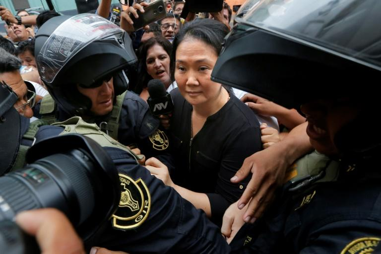 Keiko Fujimori arrives at a Lima courthouse surrounded by police