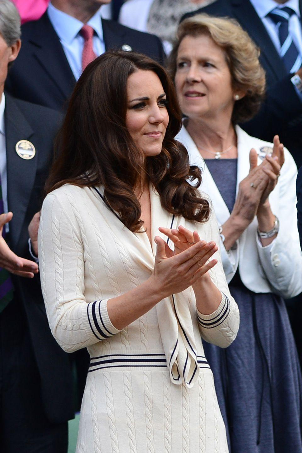 <p><strong>2012</strong> Kate wore a very Wimbledon-appropriate cream Alexander McQueen knitted dress with navy piping. </p>
