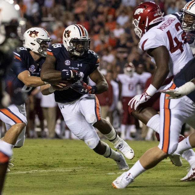 Auburn running back JaTarvious Whitlow (28) take off running against Arkansas during the first half of an NCAA college football game, Saturday, Sept. 22, 2018, in Auburn, Ala. (AP Photo/Vasha Hunt)