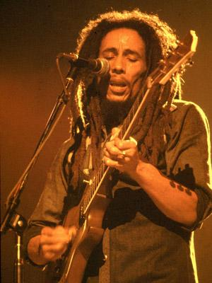 <p>Bob Marley in the groove on stage in Chicago on 27th May, 1978</p>