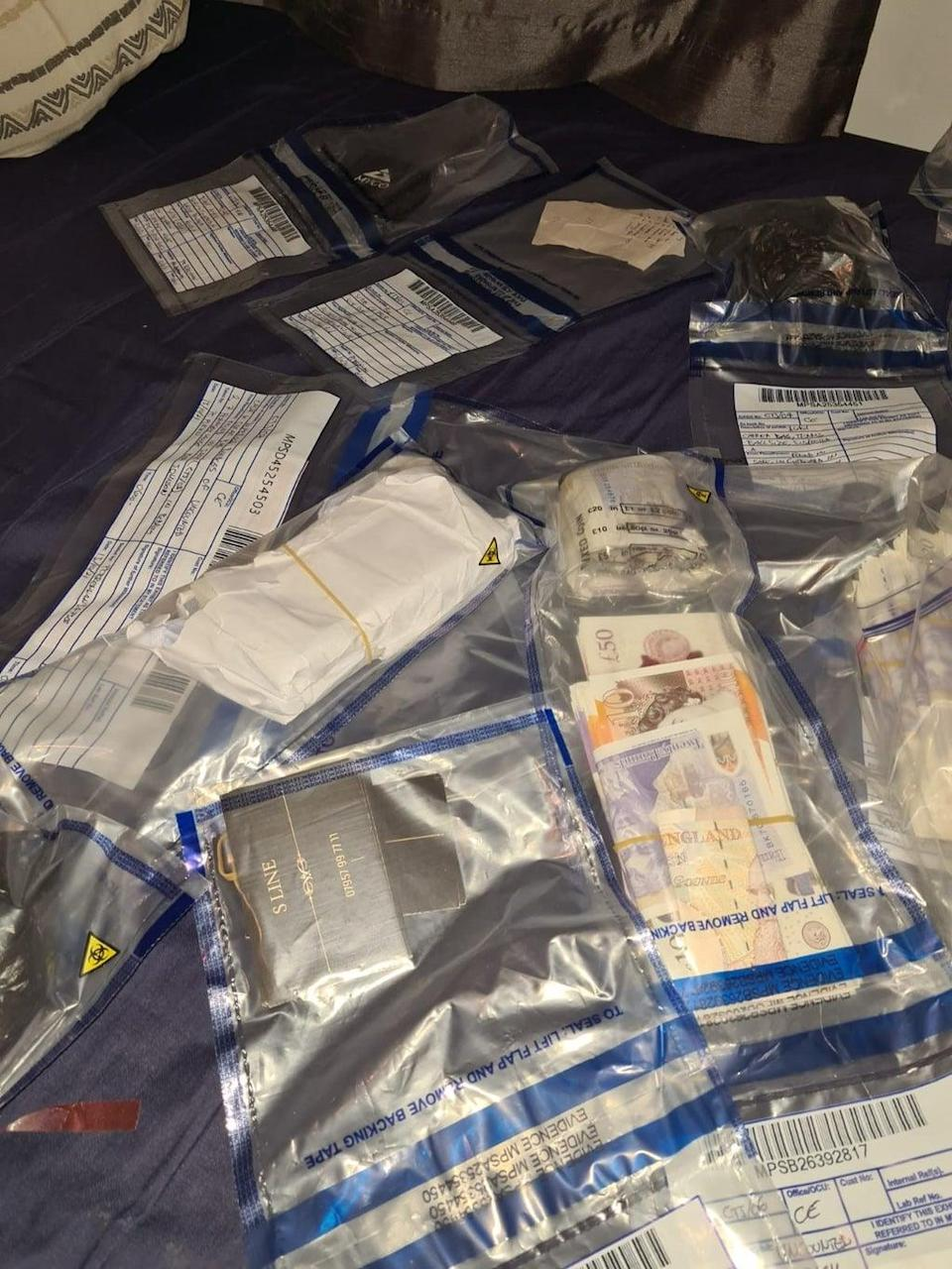 Officers also seized around £120,000 in cash during the raids (The Metropolitan Police)