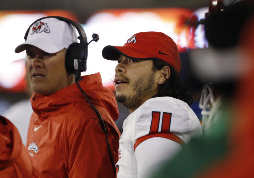 Fresno State quarterback Jorge Reyna, right, checks the scoreboard as time winds down in the team's NCAA college football game against Air Force on Saturday, Oct. 12, 2019, at Air Force Academy, Colo.(AP Photo/David Zalubowski)