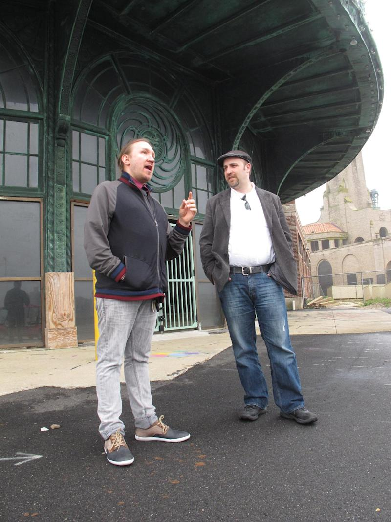 In this May 9, 2012 photo, Christian McKnight, left, senior talent buyer for concert promoter Live nation, discusses the upcoming Bamboozle Festival with Scott O'Donnell, the company's executive director of programming and festivals, in front of the old Carousel building in Asbury Park, N.J. The Bamboozle Festival will be held in Asbury Park May 18-20, headlined by Bon Jovi. (AP Photo/Wayne Parry)