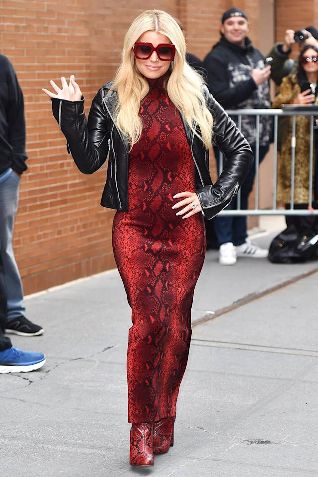 Simpson's love for animal print is a cornerstone of her vibrant wardrobe. For a Macy's press appearance Wednesday, the star teamed a red figure-hugging snake-skin print Alexander Wang dress with matching Villa Rouge Boots, oversize red Gucci sunnies and a black Balenciaga motto jacket.
