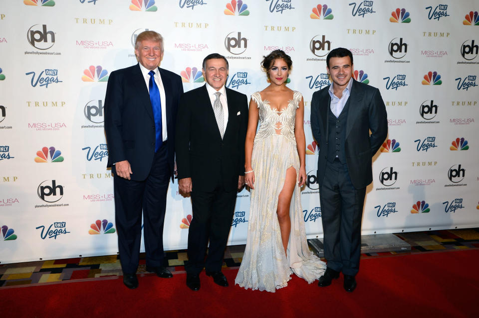 FILE – In this Sunday, June 16, 2013 file photo, from left, Donald Trump, Aras Agalarov, Miss Universe 2012 Olivia Culpo and Russian singer Emin Agalarov arrive at the Miss USA 2013 pageant, in Las Vegas. (AP Photo/Jeff Bottari, file)