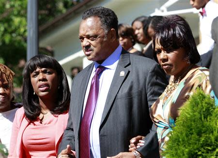 (L-R) U.S. Representative Terri Sewell, civil rights activist Reverend Jesse Jackson and Baptist minister Bernice King exit the church to attend the bell ringing and laying of the wreath at 10:22 at 16th Street Baptist Church in Birmingham, Alabama September 15, 2013. REUTERS/Marvin Gentry