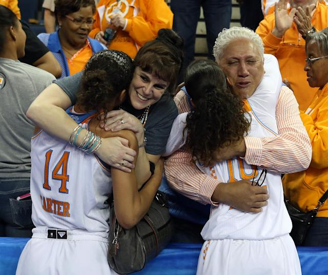 Tennessee's Andraya Carter (14) hugs her mother Jessica Lhamon and Meighan Simmons (10) hugs her father Wayne Simmons after they defeated Texas A&M 86-77 in an NCAA college basketball game in the semifinals of the Southeastern Conference women's basketball tournament Saturday, March 8, 2014, in Duluth, Ga. (AP Photo/Jason Getz)