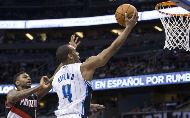 Orlando Magic's Arron Afflalo drives to the basket for two points against the Portland Trail Blazers' Dorell Wright during the first half of an NBA basketball game in Orlando, Fla., Tuesday, March 25, 2014. (AP Photo/Willie J. Allen Jr.)