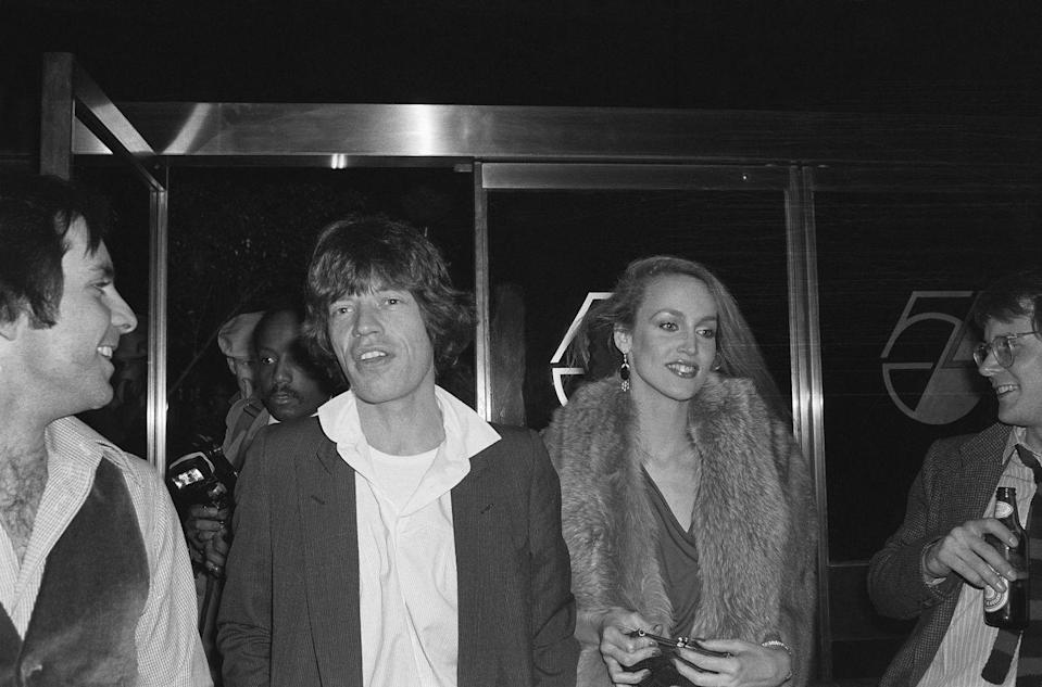 <p>Mick Jagger and his future wife, Jerry Hall, arrive at Studio 54 together for an Oscars party in 1978. </p>
