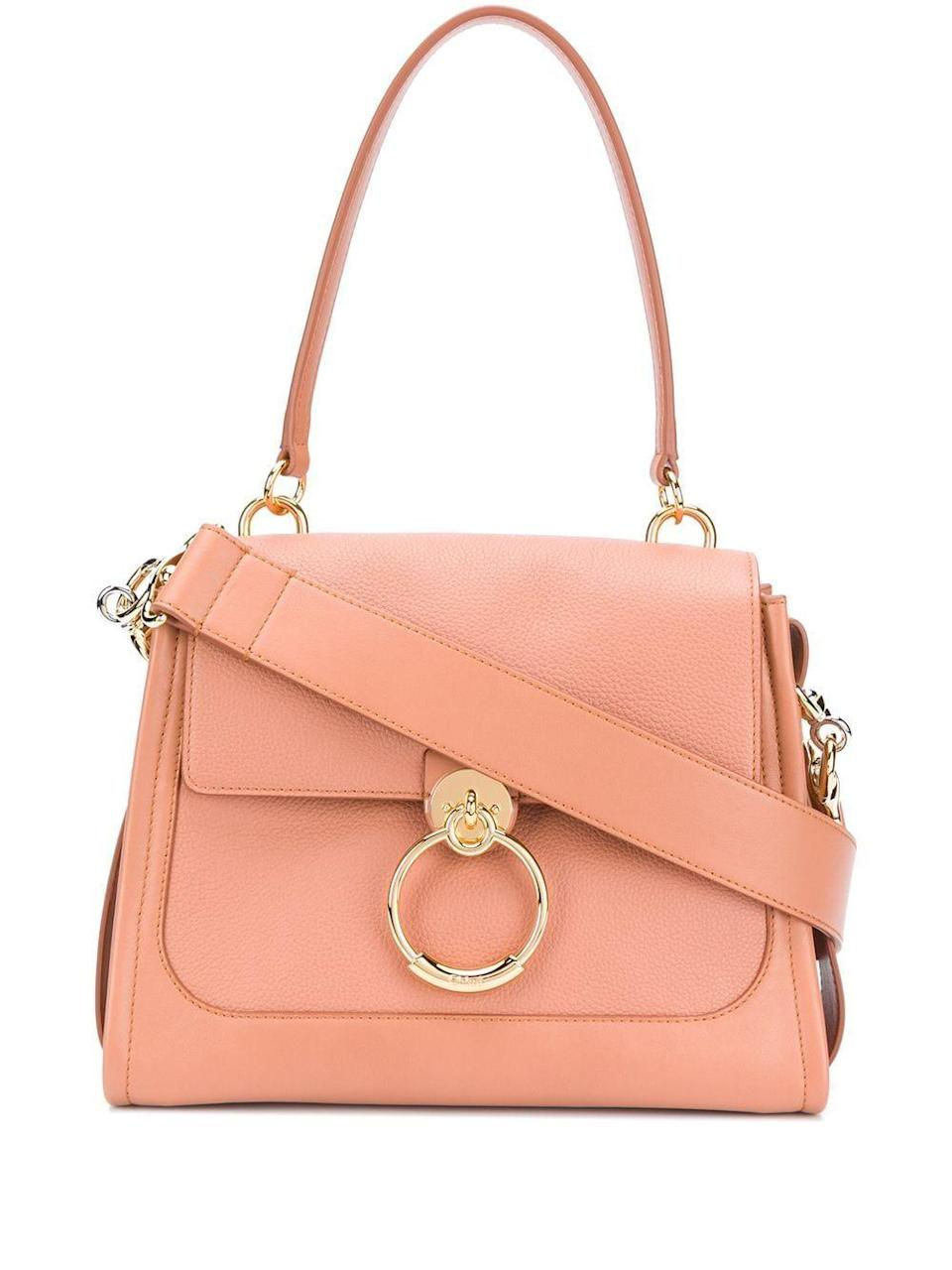 """<p><strong>Chloé</strong></p><p>farfetch.com</p><p><a href=""""https://go.redirectingat.com?id=74968X1596630&url=https%3A%2F%2Fwww.farfetch.com%2Fshopping%2Fwomen%2Fchloe-small-tess-day-bag-item-15635421.aspx&sref=https%3A%2F%2Fwww.elle.com%2Ffashion%2Fshopping%2Fg36292145%2Fmothers-day-gifts-sale%2F"""" rel=""""nofollow noopener"""" target=""""_blank"""" data-ylk=""""slk:Shop Now"""" class=""""link rapid-noclick-resp"""">Shop Now</a></p><p><strong><del>$2,187</del> $1,531 (30% off)</strong></p><p>The color of this bag will pair brilliantly with all her favorite white blouses and jeans. </p>"""