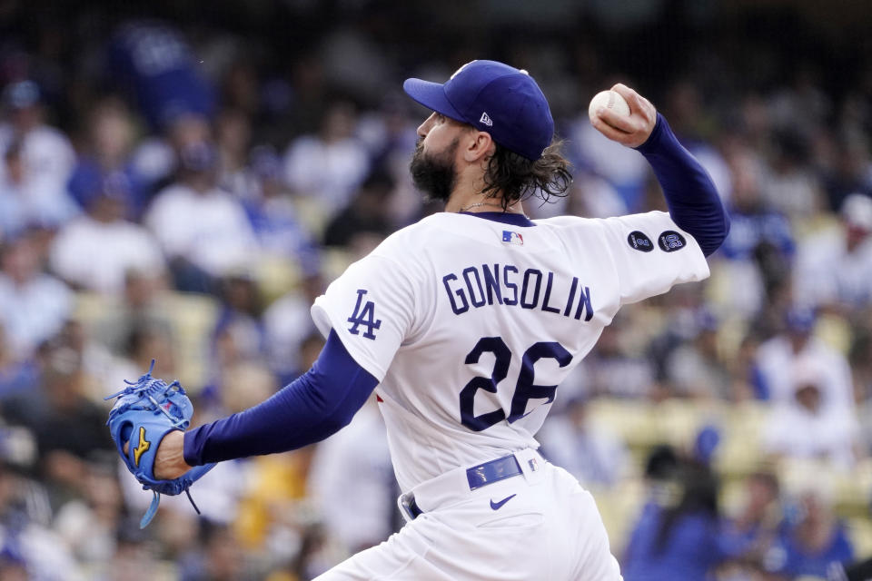 Los Angeles Dodgers starting pitcher Tony Gonsolin throws to the plate during the second inning of a baseball game against the Colorado Rockies Saturday, July 24, 2021, in Los Angeles. (AP Photo/Mark J. Terrill)