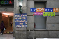 Signs displaying the numbers of recovered COVID-19 patients are displayed at an entrance to Bellevue Hospital in New York, Wednesday, Oct. 28, 2020. Hospitals in the city's public NYC Health and Hospitals' system have been upgrading their equipment, bracing for a potential resurgence of coronavirus patients, drawing on lessons learned in the spring when the outbreak brought the nation's largest city to its knees. (AP Photo/Seth Wenig)