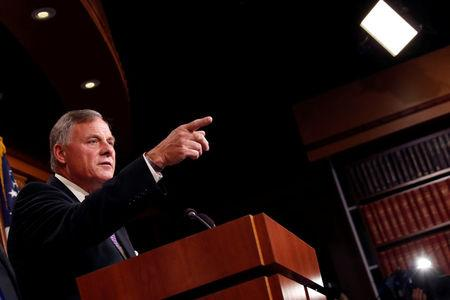 FILE PHOTO - Sen. Richard Burr (R-NC) gives an update on the ongoing investigation into Russian involvement in the 2016 election at the Capitol Building in Washington, U.S., October 4, 2017. REUTERS/Aaron P. Bernstein