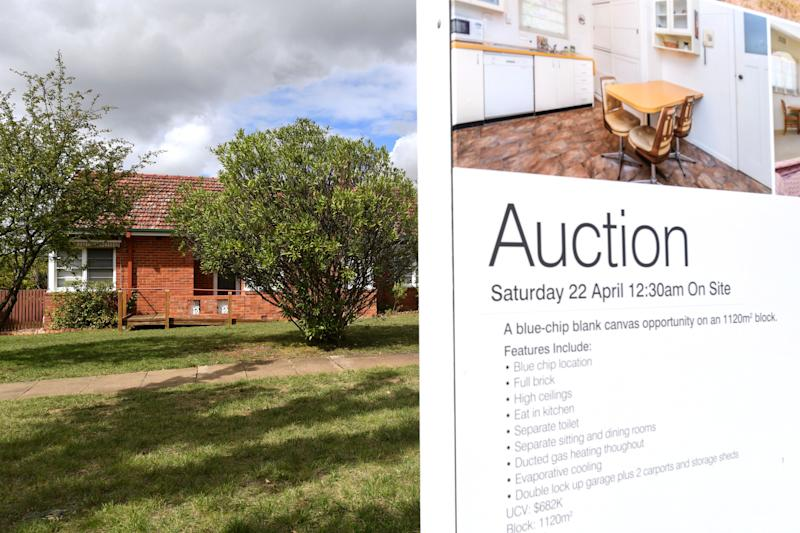 A real estate advertising board is seen in Canberra, Tuesday, April 4, 2017. (AAP Image/Lukas Coch) NO ARCHIVING