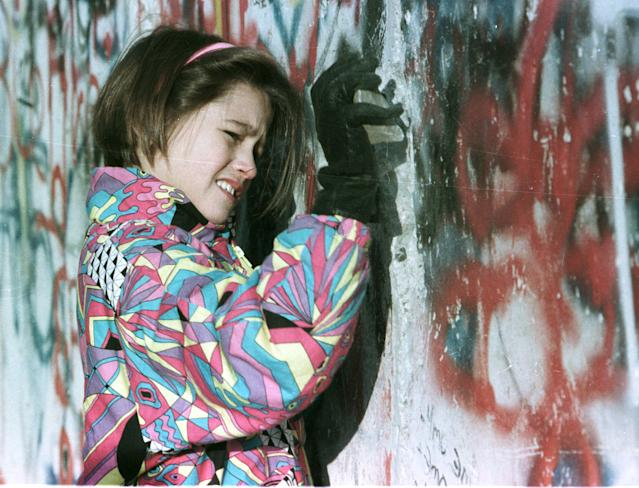 A young West German carves into the Berlin Wall with a rock on Nov. 19, 1989. (Photo: Michael Urban/Reuters)