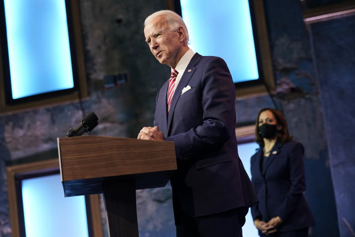 FILE - In this Nov. 16, 2020 file photo, President-elect Joe Biden, accompanied by Vice President-elect Kamala Harris, speaks about economic recovery at The Queen theater, in Wilmington, Del. Amid the new coronavirus pandemic that has devastated the continent for eight months, U.S. voters elected Biden for president, who has promised a more compassionate approach to immigration. (AP Photo/Andrew Harnik, File)