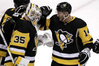 Pittsburgh Penguins goaltender Tristan Jarry (35) celebrates with Stefan Noesen (14) after shutting out the St. Louis Blues 3-0 in an NHL hockey game in Pittsburgh, Wednesday, Dec. 4, 2019. (AP Photo/Gene J. Puskar)