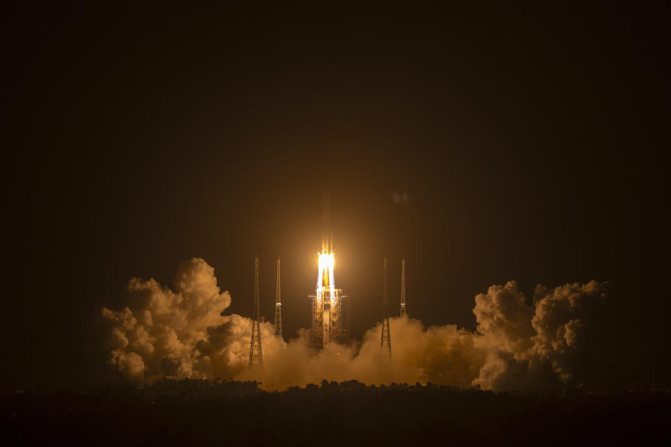 A Long March-5 rocket carrying the Chang'e 5 lunar mission lifts off at the Wenchang Space Launch Center in Wenchang in southern China's Hainan Province, early Tuesday, Nov. 24, 2020. China launched an ambitious mission on Tuesday to bring back material from the moon's surface for the first time in more than 40 years — an undertaking that could boost human understanding of the moon and of the solar system more generally. (AP Photo/Mark Schiefelbein)