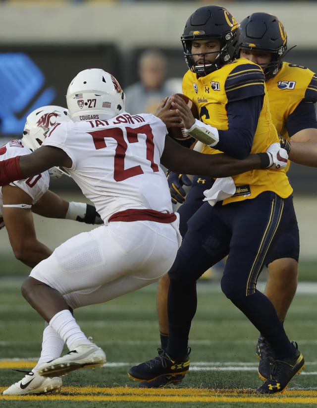 Washington State's Willie Taylor III (27) pressures California quarterback Devon Modster, right, during the first half of an NCAA college football game Saturday, Nov. 9, 2019, in Berkeley, Calif. (AP Photo/Ben Margot)