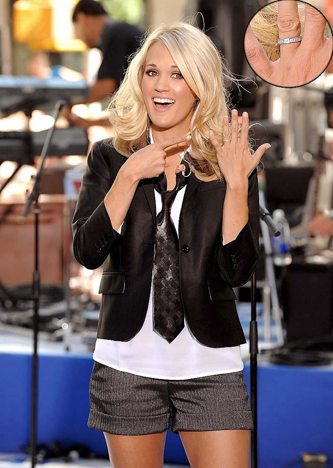 "Fresh from her honeymoon in Bora Bora, singer Carrie Underwood unveiled her wedding bling from the Ottawa Senators' Mike Fisher while performing on NBC's ""Today"" show at Rockefeller Center in New York City Friday. After tying the knot in Georgia on July 10, Fisher commented that so far, married life is ""a lot like dating life."" Dimitrios Kambouris/<a href=""http://www.wireimage.com"" target=""new"">WireImage.com</a> - July 30, 2010"